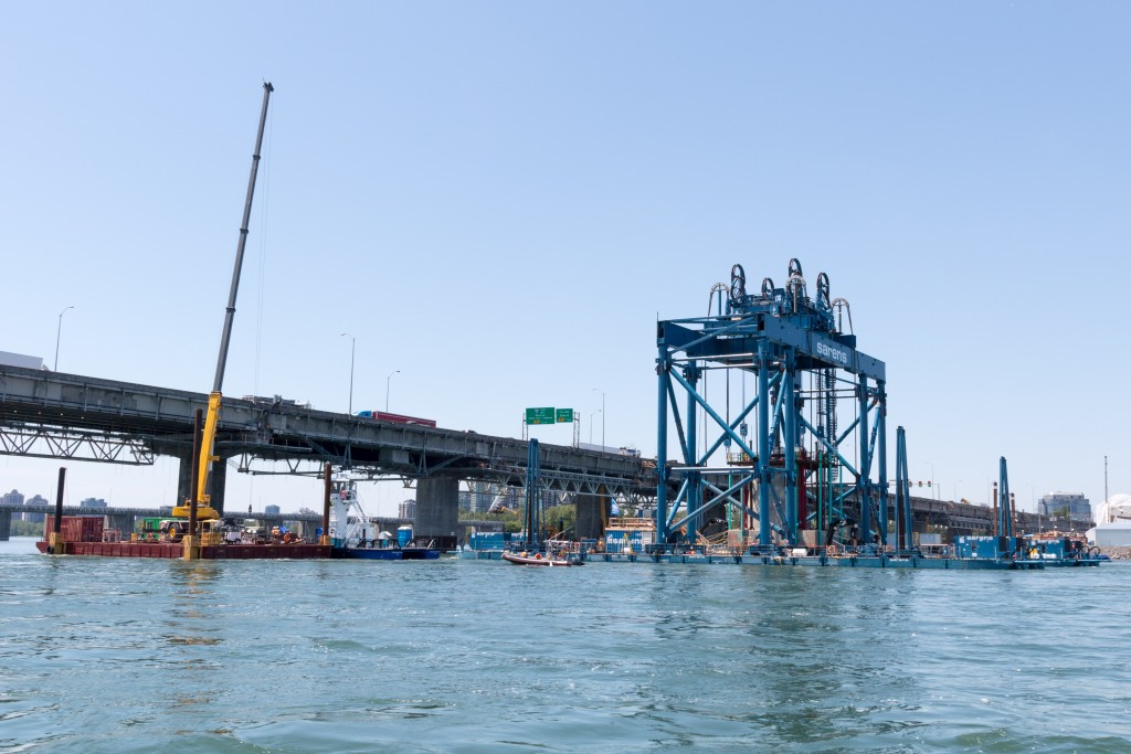 Installation of the bridge's first foundation into water